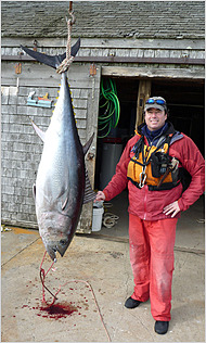 Dave Lamoureux with the 157-pound bluefin, a record tuna for an unassisted kayak fisherman.  Copyright NY Times.