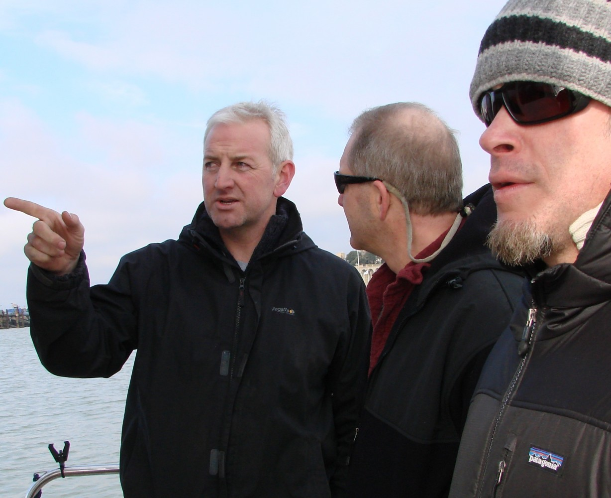 Merlin Jackson advising US fishermen Rick Bellavance and John McMurray